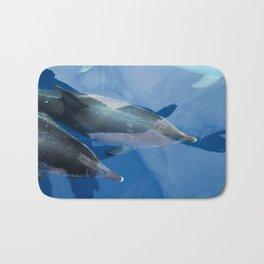 Dolphins and human shadows Bath Mat