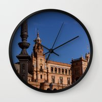 spain Wall Clocks featuring Square Spain - Seville, Spain by Richard Torres Photo