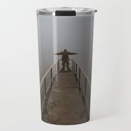 Man with open arms on a frozen pier shrouded in mist Travel Mug