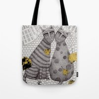 hats Tote Bags featuring Two Cats Without Hats by Judith Clay
