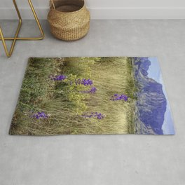 Bluebonnets with a mountain in Big Bend National Park Rug