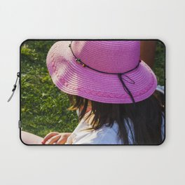 Big pink hat for a child girl on the grass Laptop Sleeve