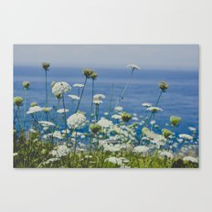 Flowers by the Beautiful Blue Sea Canvas Print