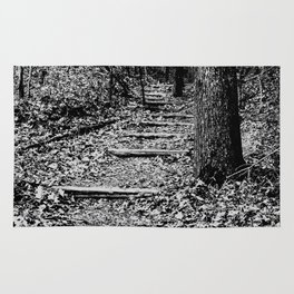 steps through the woods Rug