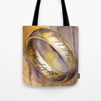 lord of the ring Tote Bags featuring One Ring by Kinko-White