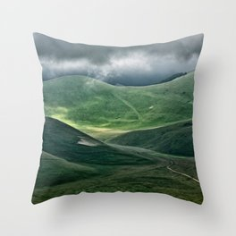 The hills of Castelluccio during a thunderstorm Throw Pillow