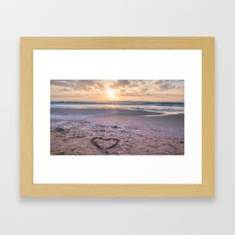 Love note Te Amo with the heart drawing on the beach at sunrise Framed Art Print