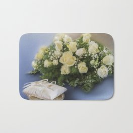 bridal bouquet and wedding rings Bath Mat