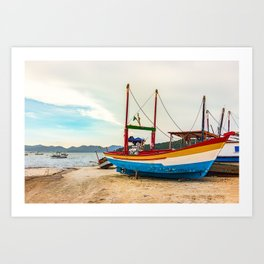 Colorful wooden fishing boat at the beach in Porto Belo, Brazil. Art Print