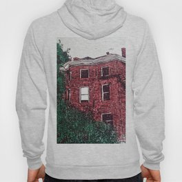 red brick house obstructed by trees linocut Hoody