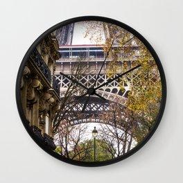 Eiffel Tower in Between Buildings Wall Clock