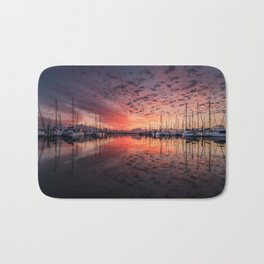 Sunset on the Water with Sailboats Bath Mat