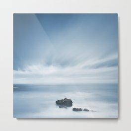 Dark rocks in a blue ocean under cloudy sky in a bad weather. Metal Print