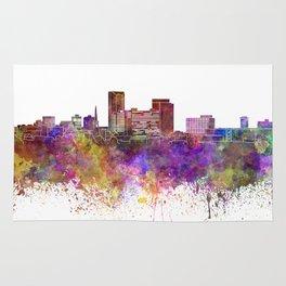 Lexington skyline in watercolor background Rug