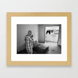 Portrait of a homeless man at home Framed Art Print