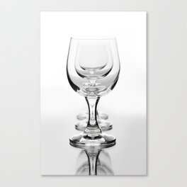 Three empty wine glasses in a row Canvas Print
