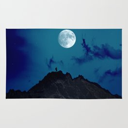 Man on a mountain top at night Rug