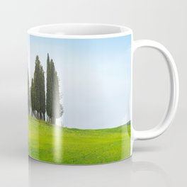 Beautiful spring minimalistic landscape with Italian Cypress on the green hills in Tuscany countrysi Coffee Mug