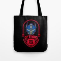 optimus prime Tote Bags featuring Optimus by Buby87