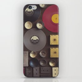 Music. Vintage wall with vinyl records and audio cassettes hung. iPhone Skin