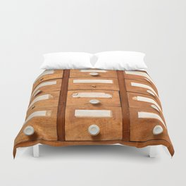 Backgrounds and textures: very old wooden cabinet with drawers Duvet Cover