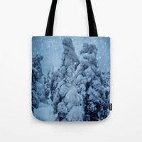 finland Tote Bags featuring Winter in Lapland, Finland by Guna Andersone & Mario Raats - G&M Studi