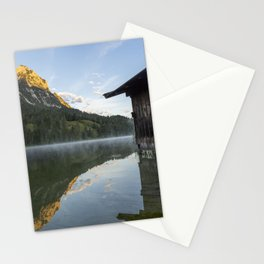 Misty Lake Portrait with boathouse. Amazing shot of a wooden house in the Ferchensee lake in Bavaria, Germany, in front of a mountain belonging to the Alps. Scenic foggy morning scenery at sunrise. Stationery Cards