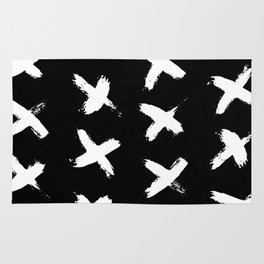 The X White on Black Rug