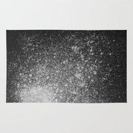 Gray Spray Paint on Black Rug
