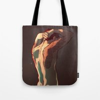 tattoos Tote Bags featuring Wing Tattoos by rdjpwns