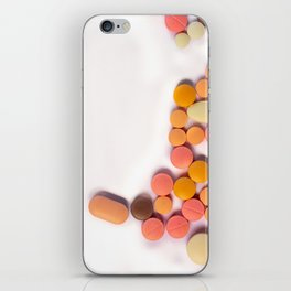 Numerous colorful pills on white background. iPhone Skin