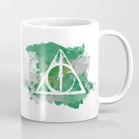 deathly hallows Mugs featuring The Deathly Hallows (Slytherin) by FictionTea