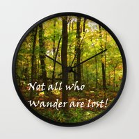not all who wander are lost Wall Clocks featuring Not All Who Wander... by Lyle Hatch