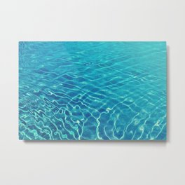 Ripples and wave patterns on crystal clear blue water Metal Print