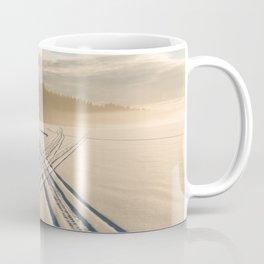 Crossing tracks on snow covered frozen lake Coffee Mug