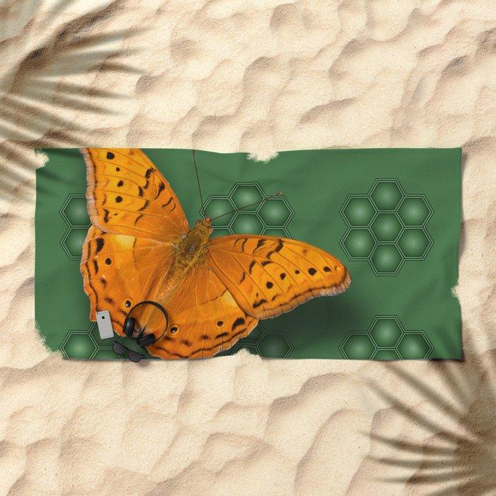 Beautiful orange butterfly on green pattern background Beach Towel