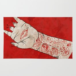 bite the hand. Rug
