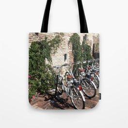 Bikes Along a Brick Wall Tote Bag