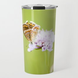 Butterfly on a flower Travel Mug