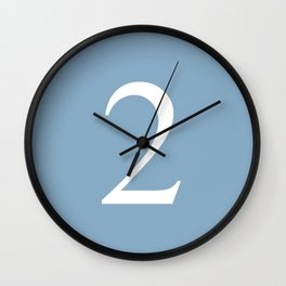 number two sign on placid blue color background Wall Clock