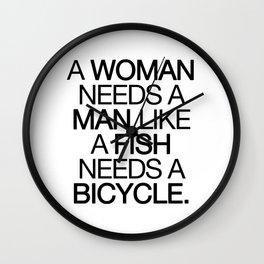 a woman needs a man... Wall Clock