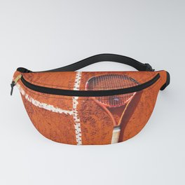 Tennis racket with ball on tennis court Fanny Pack