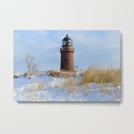 Sturdy Lighthouse on a Rocky Coast in Winter Metal Print
