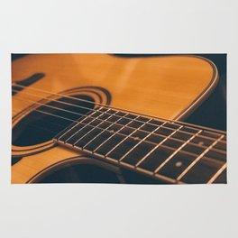 Acoustic guitar closeup Rug