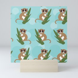 pattern - lemur on green branch on blue background Mini Art Print