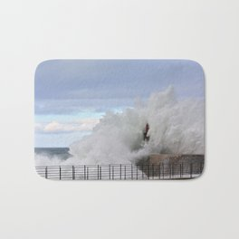 Stormy wave over old lighthouse and pier of Viavelez in Asturias, Spain. Bath Mat