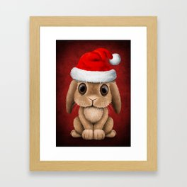 Cute Floppy Eared Baby Bunny Wearing a Santa Hat Framed Art Print