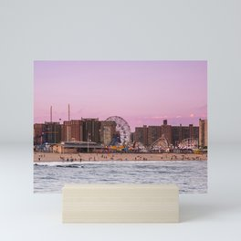 Sunset on the beach of Luna Park in Coney Island New York City Mini Art Print