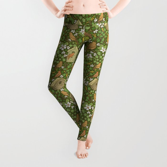 Birds in birdhouses with white apple blossom on brown background Leggings
