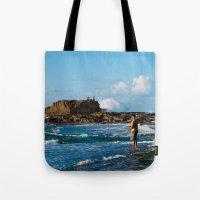 puerto rico Tote Bags featuring Pescador en Villa Pesquera, Isabela, Puerto Rico by Silmagerie